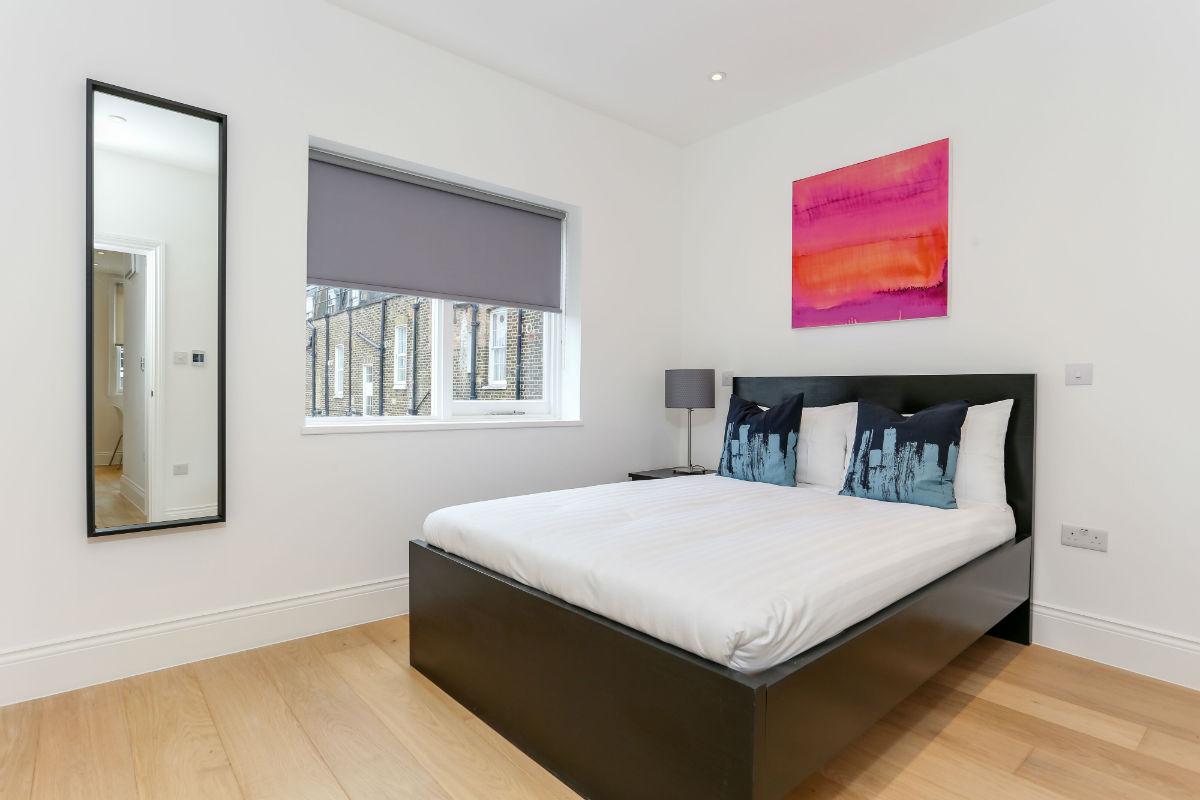 Double bed in a one bedroom apartment next to Kings Cross station London