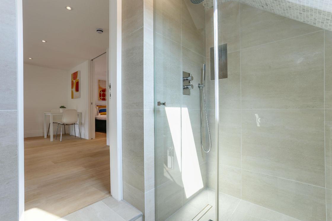 Walk in shower in a modern bathroom in kings cross apartment
