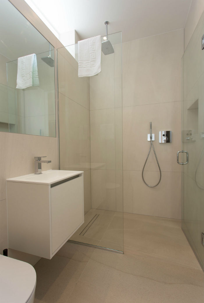 Modern bathroom with walk in shower in a studio apartment in London Fitzrovia