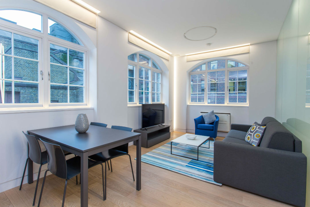 Open plan living room with large windows in Mornington Crescent