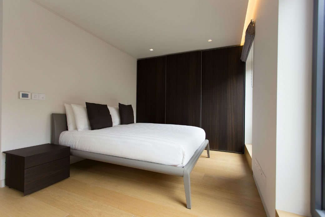 Double bedroom with built in wardrobe in Soho London