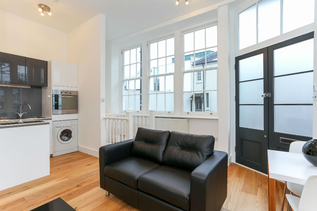 Sofa and large windows in the living room in St Johns Wood