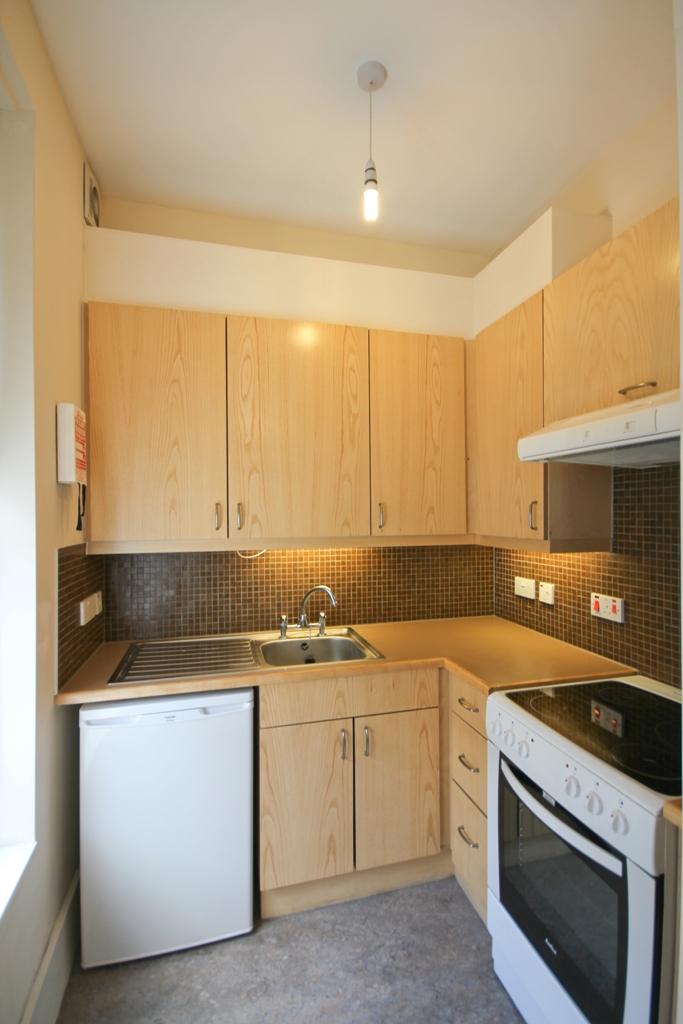 Fully equipped kitchen with fridge/freezer and oven in Warren Street London