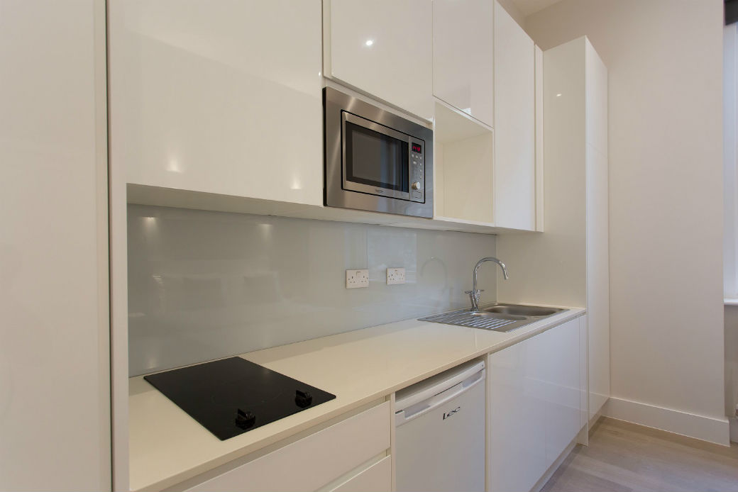 Fully equipped modern white kitchenette in Holloway London studio flat