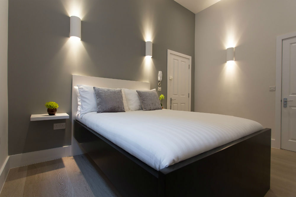 Double bed and modern lighting in a studio flat in Holloway