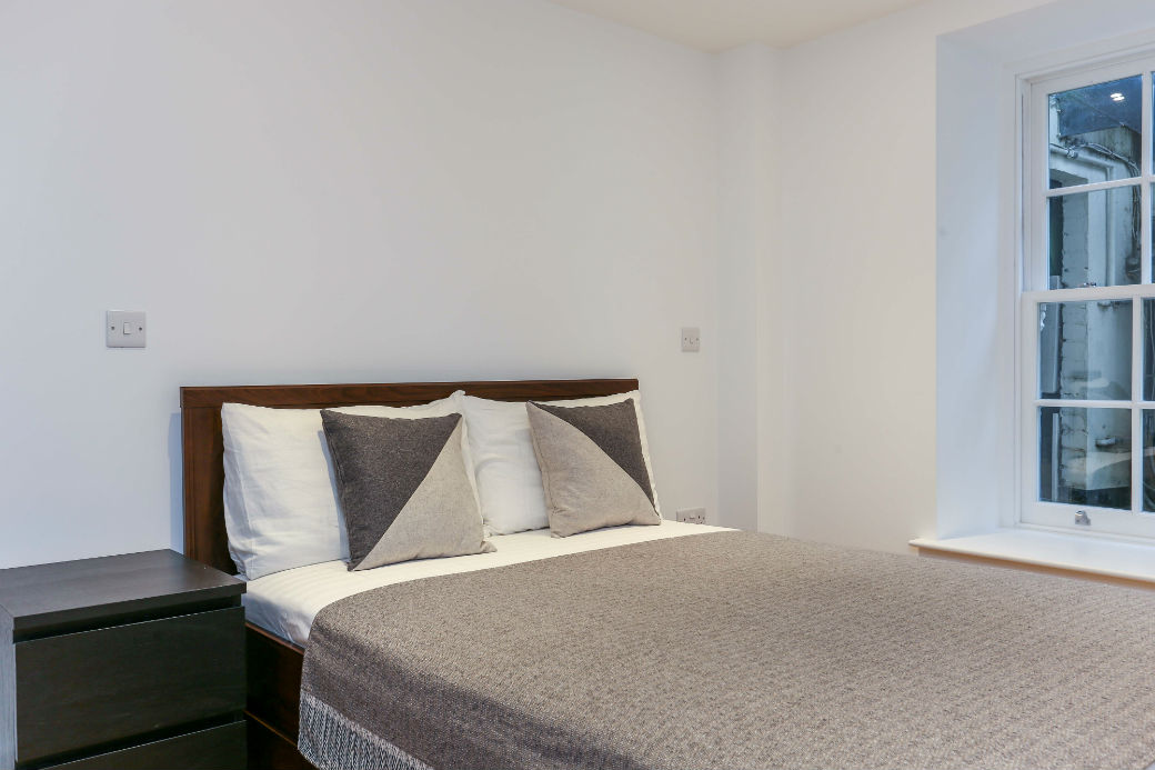 Double bed in one bedroom apartment on Alma Square